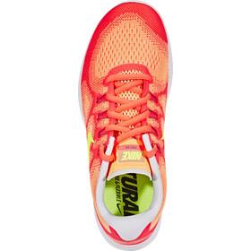 Nike Free RN 2 Running Zapatillas running Mujer, sunset glow/volt-hot punch-violet dust